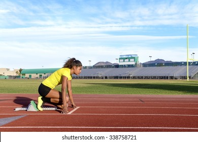 Female Sprinter Getting Ready to Start The Race