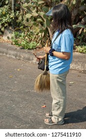 Female staff with broom and slingshot