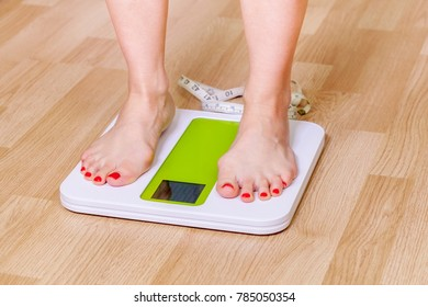 Female standing on weighing scale