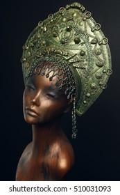 Female statue in green metal head decoration