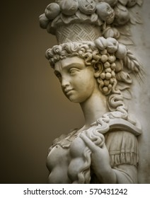 Female statue in a square in Florence Italy