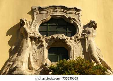 Female statues on a yellow Secessionist house in Budapest