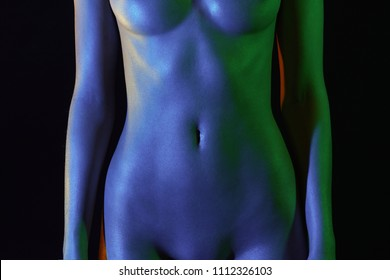 female stomach and chest, plastic surgery. Nude Woman in Colorful bright lights. sparkling shiny Rainbow Naked body parts of Girl