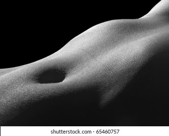 Female stomach isolated on black background.