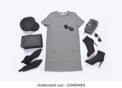 female stripy sundress clothes with black handbag ,high hell shoes ,hat ,sunglasses on white background