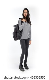 Female student with a backpack on white background