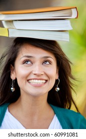 Female student balancing books on top of her head