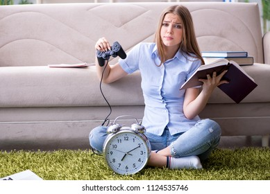 Female student being distracted from exam preparation