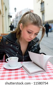 The female student in cafe street in old city