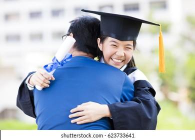 female student and family hug celebrating graduation