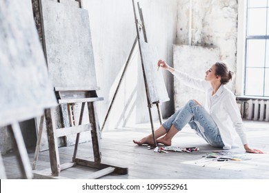 Female student having classes at art studio, to draw. Woman painting.