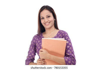Female student holding books