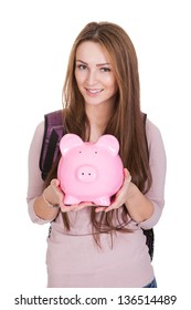 Female Student Holding Piggybank Over White Background