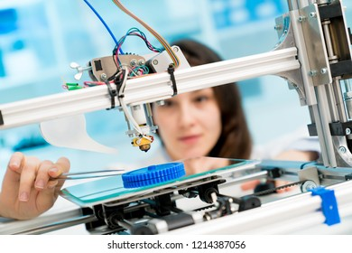female student or laboratory assistant in the automation laboratory is debugging the work of the 3d printer. 3d printer is a device for modeling objects