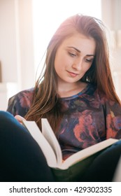 Female Student Learning From A Book