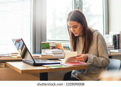 Female student learning in library