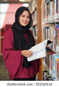 A female student in a library.