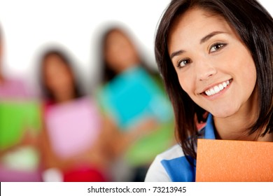 Female student smiling with a group behind ? isolated