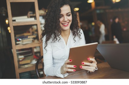 Female student studying on tablet for university