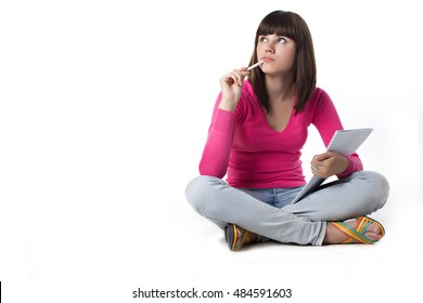 female student thinking with note pad.