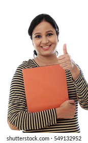 Female student with thumb up gesture