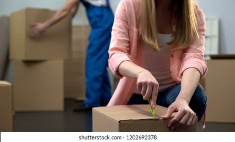 Female student unpacking things in room, moving company worker carrying baggage