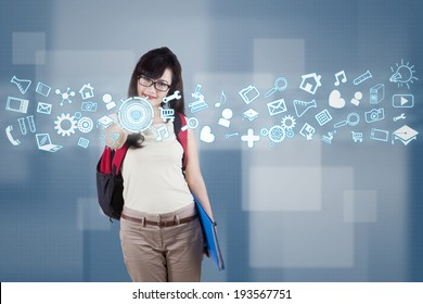 Female student using futuristic interface for accessing information