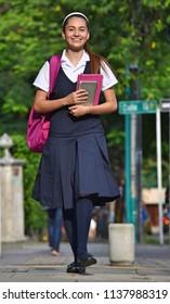 Female Student Walking To School