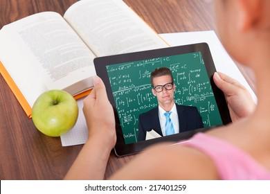 Female student watching education tutorials on digital tablet