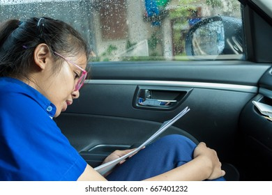 Female students are reading in the car in-THAILAND.