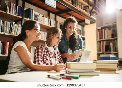 Female students study in the college library.Learning and preparing for exam.