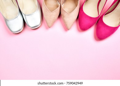 Female stylish shoes on color background