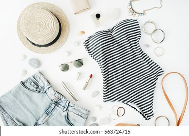 Female summer bikini swimsuit, clothes and accessories collection on white. Flat lay, top view