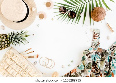 Female, summer street style. Women's frame of accessories. Sundress-dress, straw hat, bag, sunglasses, camera and pineapple. Top view, flat lay.