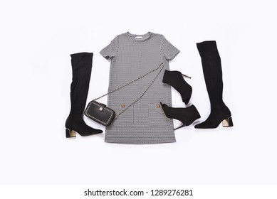 female sundress clothes with black handbag ,high hell shoes ,hat ,boot, on white background