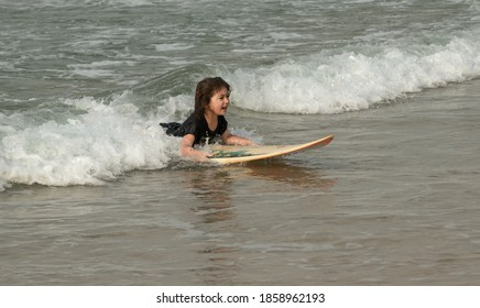 female surfer on the beach on a sunny day. Israel, Ashkelon October 31, 2020