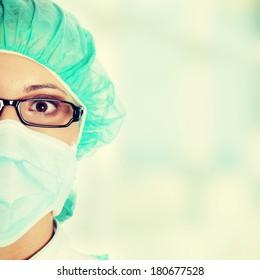 Female surgeon or nurse wearing protective uniform