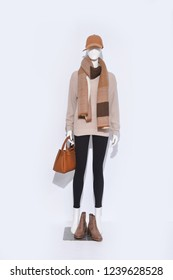 female sweater clothing with black pants ,hat ,scarf ,handbag ,shoes on full mannequin