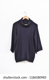 female sweater clothing on hanging