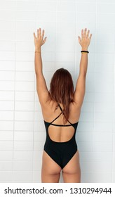 female swimmer and sportsman with arms raised