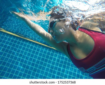 Female swimmer at the swimming pool in Feb 18, 2017 at Phuket Thailand.