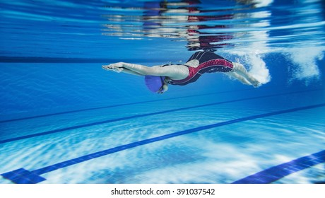 Female swimmer swimming pool.Underwater picture