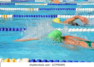 Female swimmers in a tight freestyle race