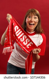 Female Swiss sports fan smiling and cheering for their team.