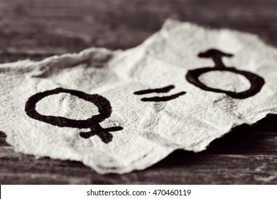 a female symbol, an equals sign and a male symbol drawn on a piece of paper depicting the women equality