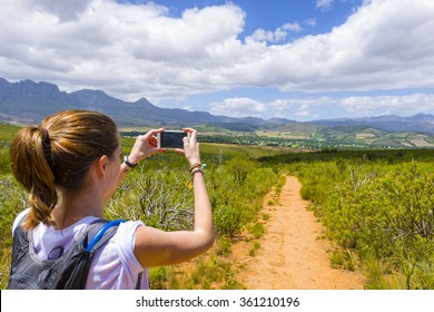Female taking photo of Helderberg Nature reserve, Somerset West, Cape Town, South Africa