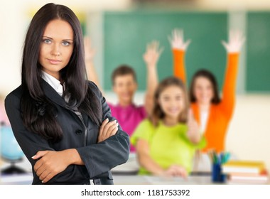 Female teacher with children at class on