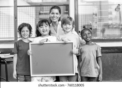 Female teacher with classroom at elementary school.