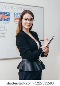 Female teacher in classroom English language school.
