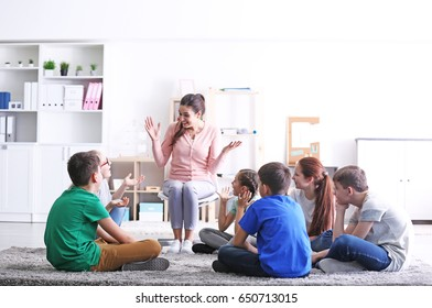 Female teacher conducting lesson at school